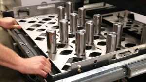 Machine tending system slide